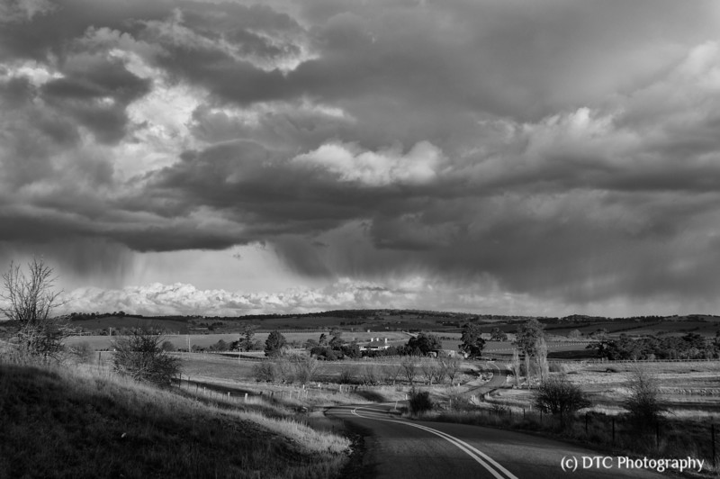 Storm clouds over the historic homestead of Braemar House, Range Rd