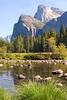 Cathedral Rocks over the Merced River in Yosemite Valley, with Bridal Veil Falls in the background.<br /> September 2005.