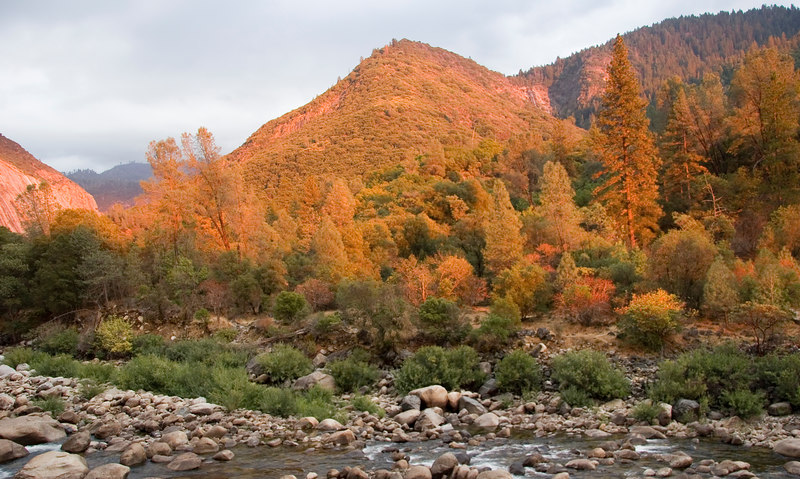 The Merced River and warm sunlight on the fall foilage outside the southern entrance to the park.<br /> October 2006.