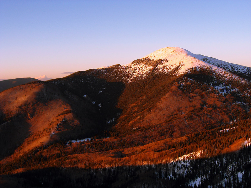 A winter sunset on Santa Fe Baldy, Pecos Wilderness, February 2007.