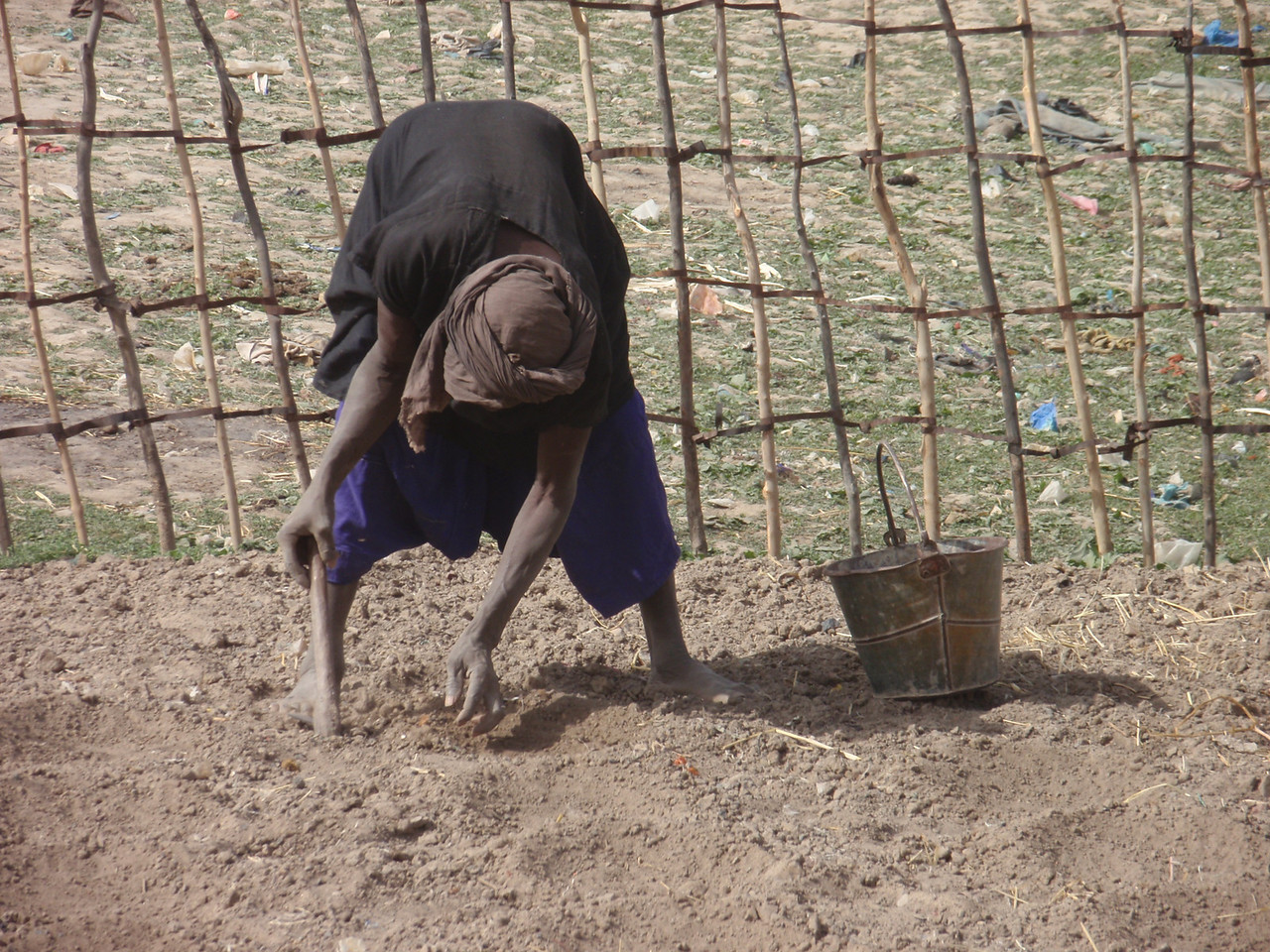257_Mopti  The Fula Quarter  Woman Planting Seeds