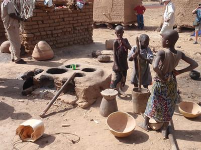 236_Parandougou   A Bobo Tribe Village  Kids Pounding Millet