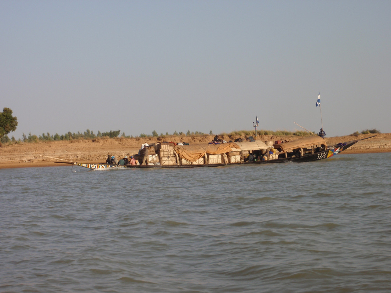 359_Niger River  Pirogue Carrying a Variety of Goods