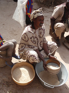 276_Mopti  The Fula Quarter  Woman Cleaning the Grain
