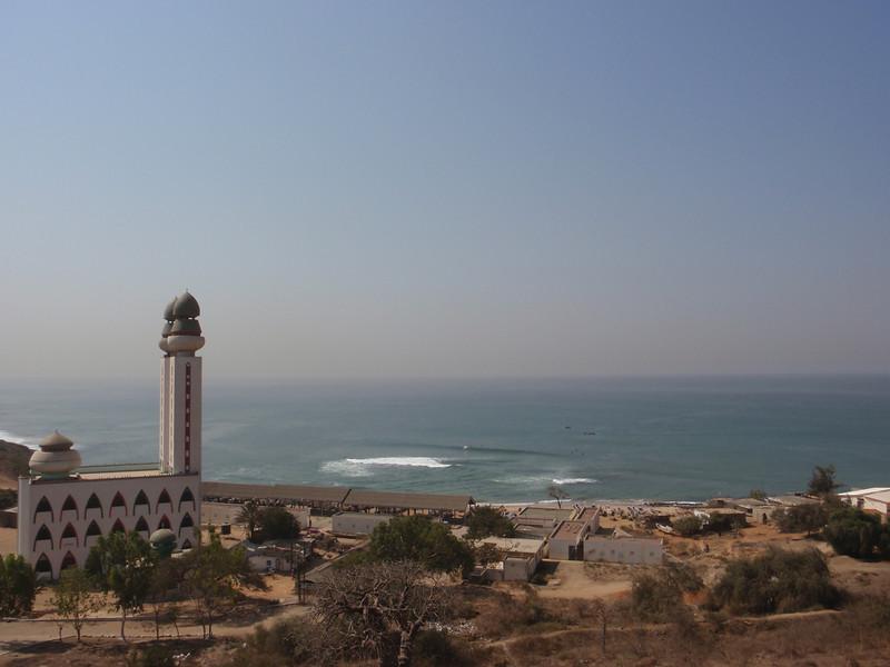 037_The Mosquee de la Divinite perched on a calm stretch of shore