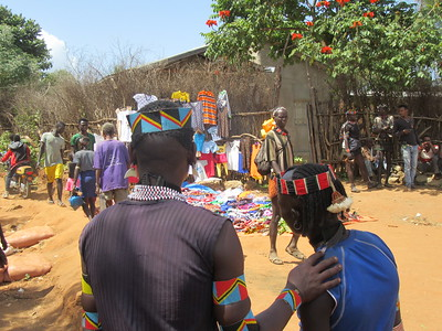 869_Key Afer  Market Day  Left, Ari Tribe Men (Blue and Black)  Right, Banna Tribe Men (Red and Black)
