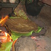 647_Dorze Village  The Enset  The False Banana Tree  cooking the Paste, over a Banana leaf