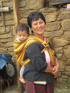 041_Upper Paro Valley  Tenzinling Resort  Grand-parent and child