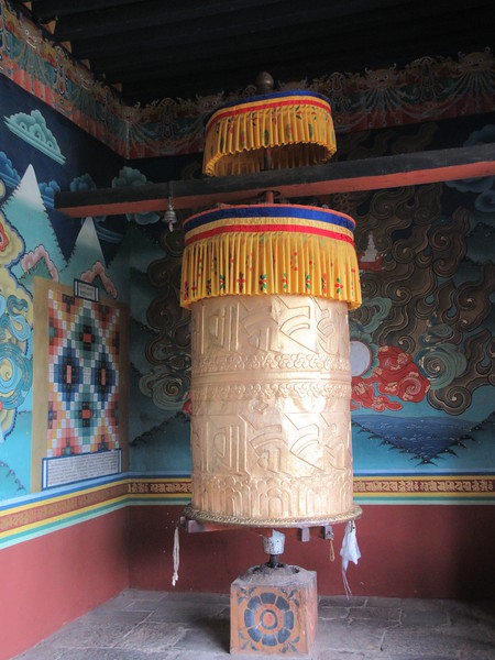 282_Punakha Dzong  Big Prayer Wheel  Holy mantras inscribed on them and rotating them brings a feeling of peace and tranquillity besides good luck