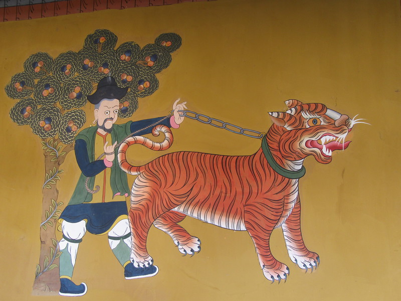 063_Paro  Rinpung Dzong  A Mongol holding a tiger on a leash  An unusual pet!