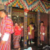 048_Men wearing the traditionel Bhutanese male dress, the Gho  A knee-length robe that ressembles a kimono