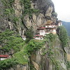 125_Takstang Gompa  Tiger's Nest  A glossy-brown sheer cliff with the monastery impossibly positionned at its very edge