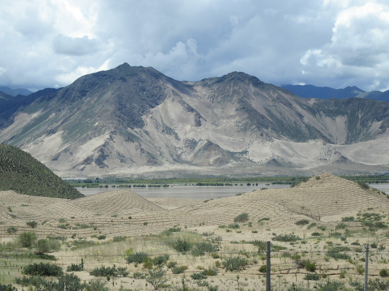052_From Samye Monastery to Yumbulakang Fort  Tsangpo River  Barren mountains and dramatic sand dunes