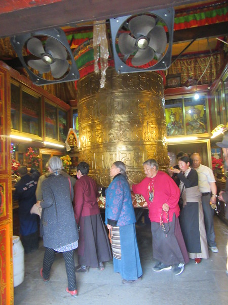 200_Lhasa  Barkhor Circuit  Mani Lhakhang  Houses a huge prayer wheel set almost continuously in motion