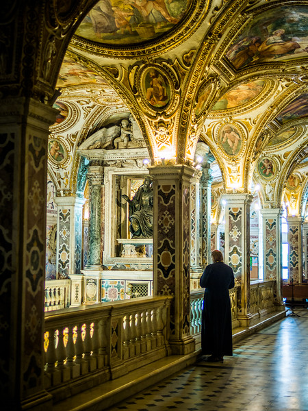 Priest Observing the Duomo Crypt, Salerno, Italy