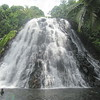 085_Pohnpei  Kepirohi Waterfalls  The falls cascade over a wide, sloped pyramid of basalt rock and fill a shallow pool