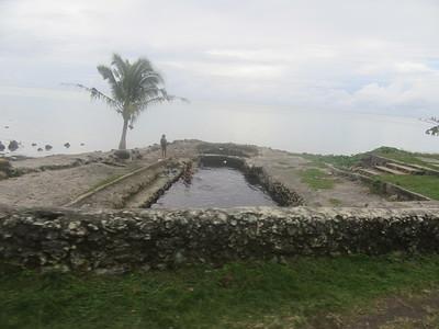 023_Oval-shaped houses sitting alongside freshwater bathing pool fed by underground springs