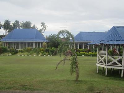 019_Upolu Island  Apia  Round Samoan houses (fale tele) with blue roofs