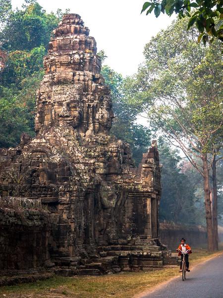 Schoolboy Passing Ta Prohm Gate, Angkor, Cambodia