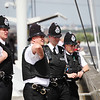 3 out of 4 policemen do the 'funky chicken'