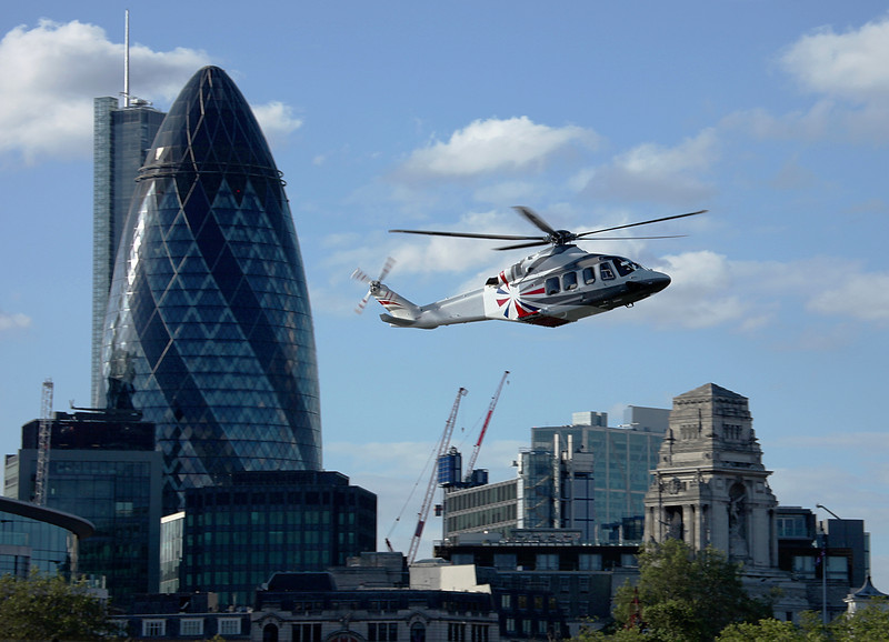 James Bond escorts the Queen past the Gherkin