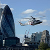 James Bond escorts the Queen past the Gherkin