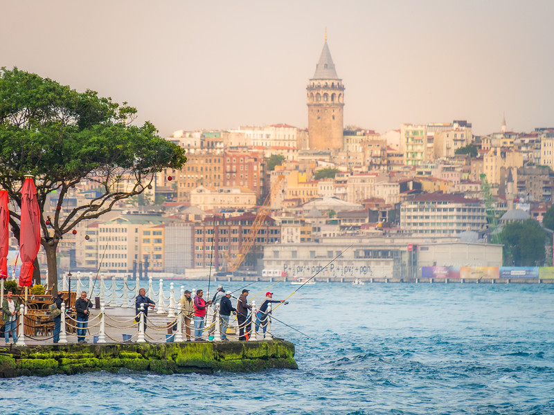 Fishermen and the Galata Tower, Istanbul, Turkey
