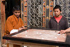 We stopped to watch men playing Carrom outside a shop in Paro. It is a very common game. A powder is spread on the table so the chips glide smoothly. It is played something like billiards or table shuffleboard.<br /> <br /> April 1, 2009