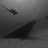 Diver swims to the bow of the wreck of the Russian Missile Frigate #356, renamed the MV Capt. Keith Tibbetts. Cayman Brac.