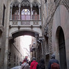 an ornate walkway above the narrow streets