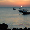 The sun sets on the dive boats off Sunset House, Grand Cayman.