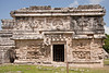 """La Iglesia"" (""The Church"") in the Las Monjas (""The Nuns"" or ""The Nunnery"") complex at Chichen Itza was actually a governmental palace and is decorated with elaborate masks of the rain god Chaac. <br /> July 13, 2011."