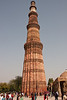 Qutb Minar is the tallest brick minaret in the world, inspired by the Minaret of Jam in Afghanistan, it is an important example of early Afghan architecture, which later evolved into Indo-Islamic Architecture. The Qutb Minar is 72.5 metres (239 ft) high, has five distinct storeys, each marked by a projecting balcony carried on muqarnas corbel and tapers from a diameter 14.3 metres at the base to 2.7 metres at the top, which is 379 steps away. It is listed as a UNESCO World Heritage Site along with surrounding buildings and monuments.<br /> March 10, 2013