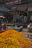 A pile of marigold flowers used to make garlands and bought lose to decorates statues of deities at home.<br /> March 10, 2013