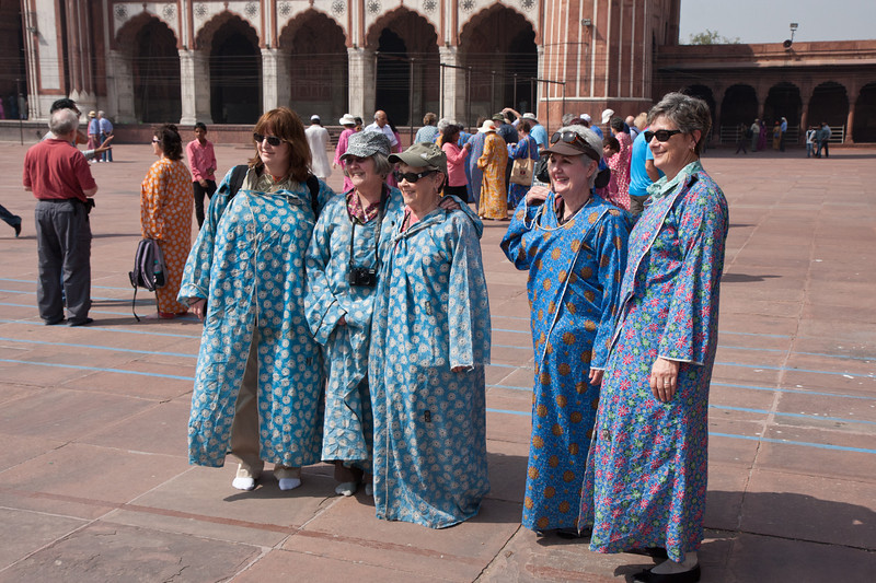 Women have to wear a robe in the mosque, luckily they had ones we could borrow but we look pretty silly. This is the Jama Mas Jid Mosque, Delhi. <br /> March 10, 2013.