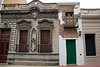 "Casa Minima (""smallest house""  -- with the green door) in Buenos Aires. This is popularly known as the ""littlest house in San Telmo neighborhood"". It was originally a carriage hose, but the owner of the mansion gifted it to his freed slaves in 1813.<br /> <br /> May 3, 2010"
