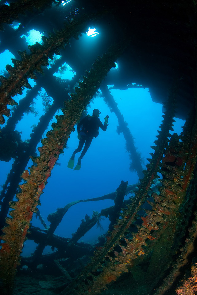 A diver inside the wreck of, Carnatic, that sank in 1869. Sha'ab Abu Nuhas, northern Red Sea, Egypt. 2012