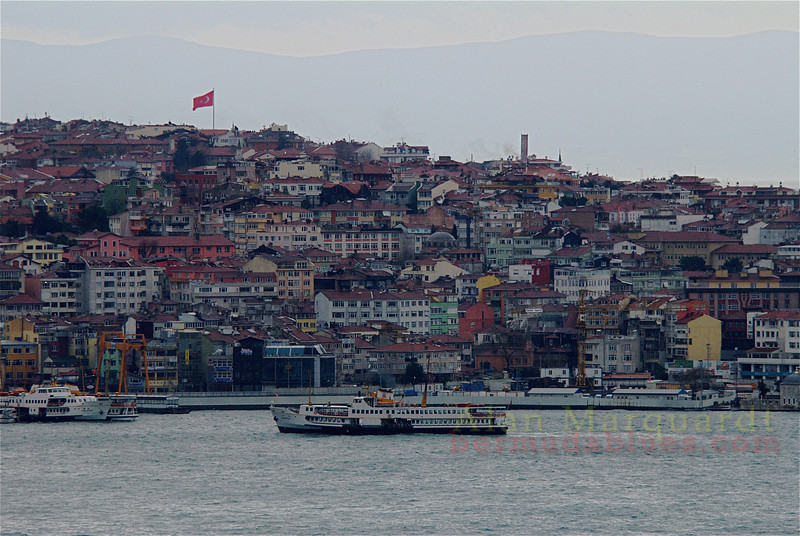Looking across the Bosphorus at the Asian side, as a ferry makes it way to the dock. Istanbul, Turkey.