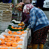 Women hand sort the good from bad, oranges. Koycegiz- Dalyan, Turkey