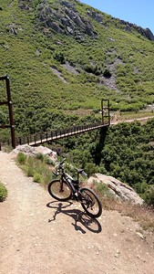 Looking down on the Bear Canyon Suspension Bridge & my bike
