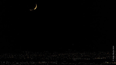 Waxing Crescent (9.7%) setting in the Oquirrh's