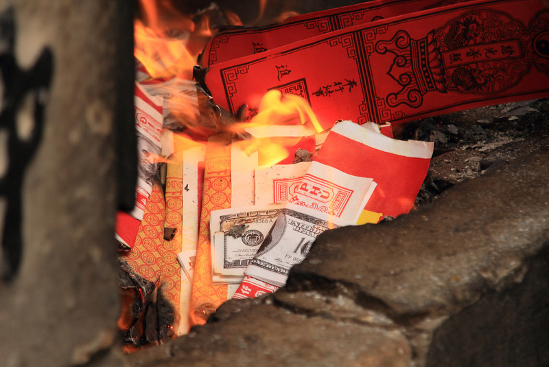"It was a special day, because all over town people were burning heaps and heaps of ""spirit money."" It's fake money to give to the deceased, so they can spend it on lavish items in the afterlife."
