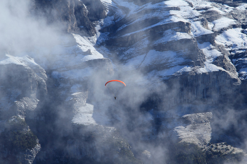 A paraglider high above the valley