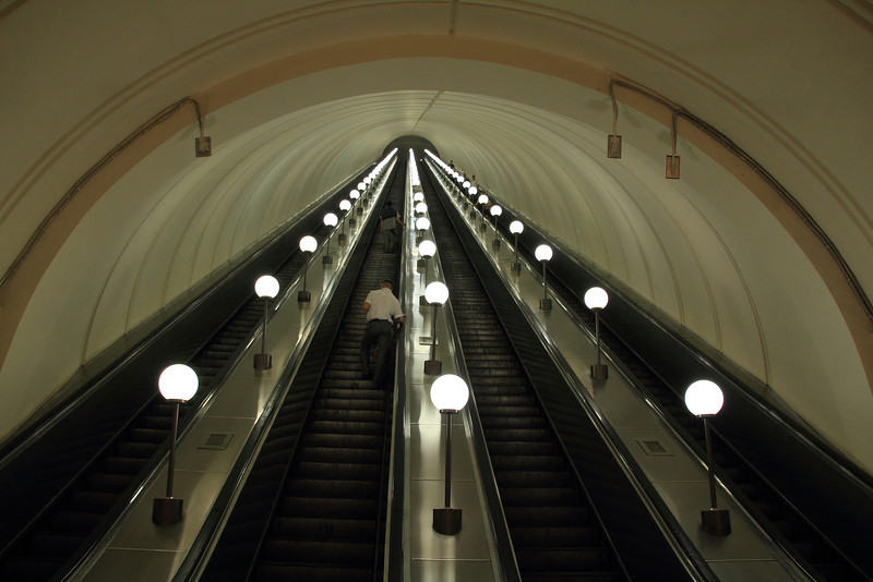 The subway is very deep in this city, and the escalator rides very long