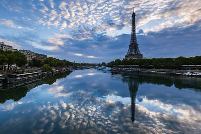 Eiffel Tower reflecting in the La Seine river