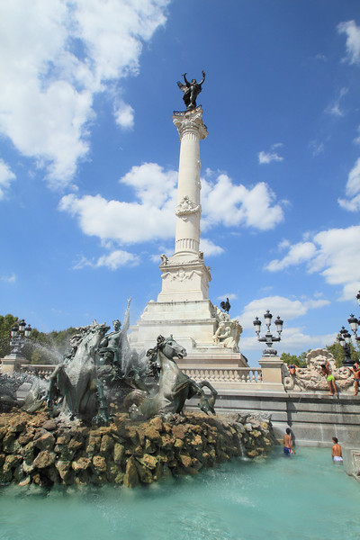 Girondists monument in Place des Quinconces. Playing in the fountain is a good way to beat the heat.