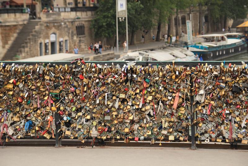Pont de l'Archevêché padlocks. It's funny, on Google Street View the fence doesn't have any locks.