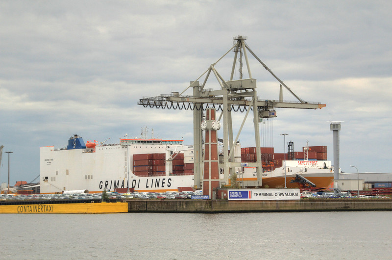 Enormous container ship being loaded