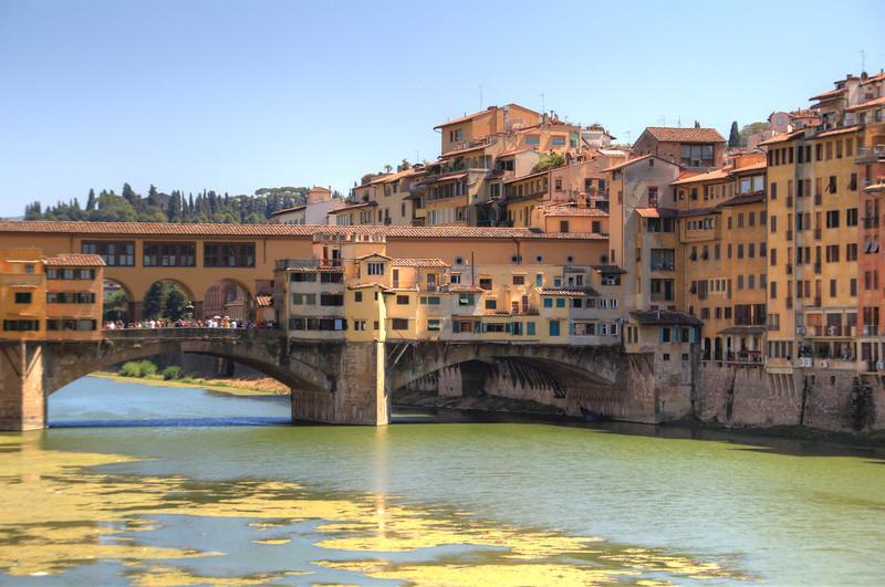 The (very green) Arno River and Vecchio Bridge