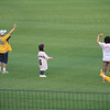 Kids doing the cheers before the game. This girl was a bit too young to know the moves...